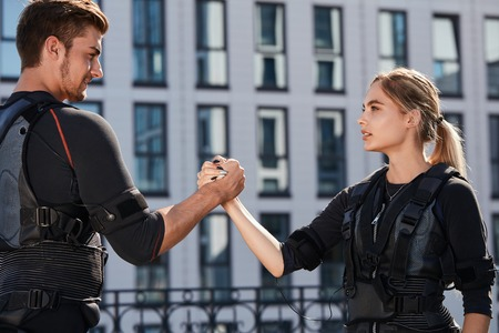 awesome guy and beautiful girl looking at each other and holding hands Stock Photo
