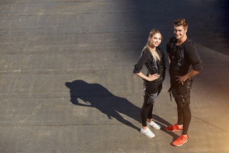 couple is ready for cross fit training with EMS Фото со стока