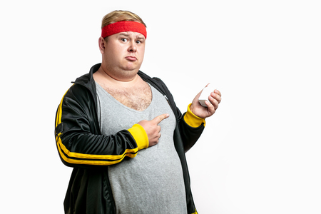 a fat man with pills in hand. Vitamins or Diabet Concept