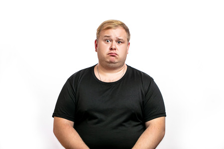 Big fat stout blonde man looking at camera with upset, disappointed expression, emotion. Isolated on white background.