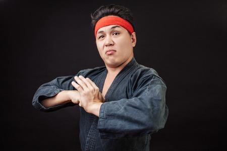 serious Karate man in karate position 版權商用圖片