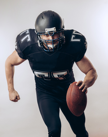 Quarterback throwing a football in a professional football game Stock Photo