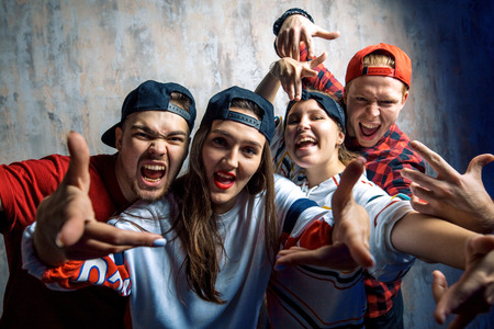group of excited rappers posing to the camera Фото со стока