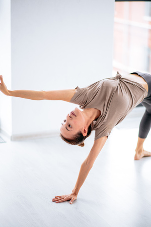 Young sporty emotional woman dancing in the studio , Wild Thing pose 写真素材