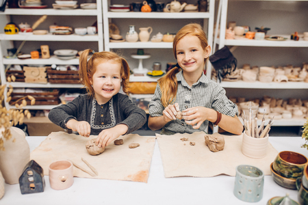 adorable little students posing to the camera in the art studio