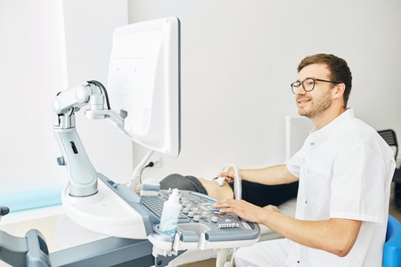 happy therapist scanning the client