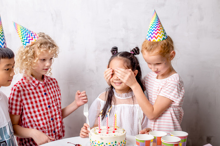 close up photo. children want to congratulate their best friend with anniversary