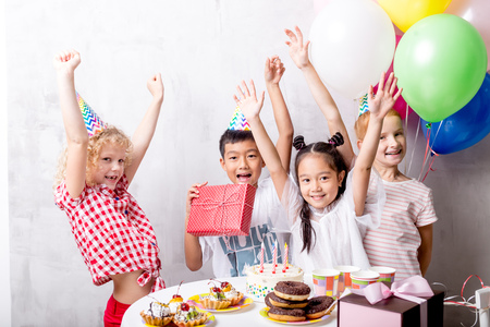 Group of kids celebrate birthday party together Stock Photo