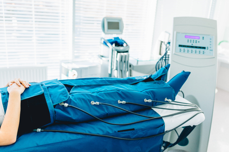 legs pressotherapy machine on woman patient in hospital bed