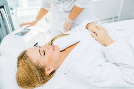 Non-surgical face lifting. SMAS lifting ultrasonic. Facelift.