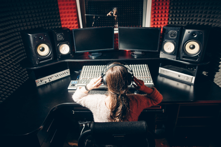 young DJ regulating the music Banco de Imagens