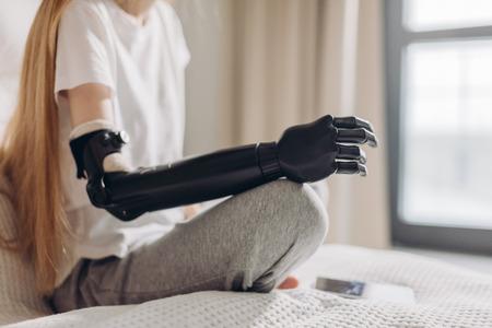 close up cropped photo. focus on the iron robotic arm.prosthetic amputee rehabilitation. Archivio Fotografico