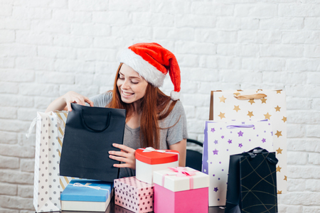attractive cheerful girl with Christmas gifts, season of gifts. creative present for family