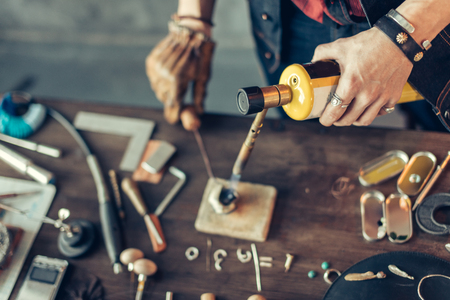 jeweler maker using a soldering torch, close up cropped photo Stock Photo