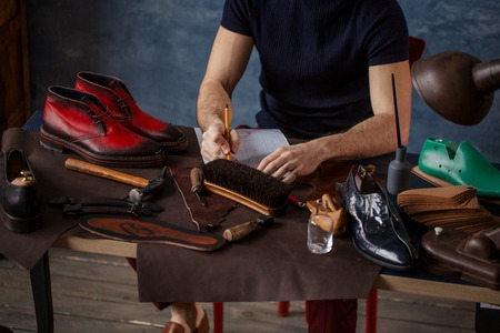 male inventing fashion trend , close up cropped photo. creation of shoe brand