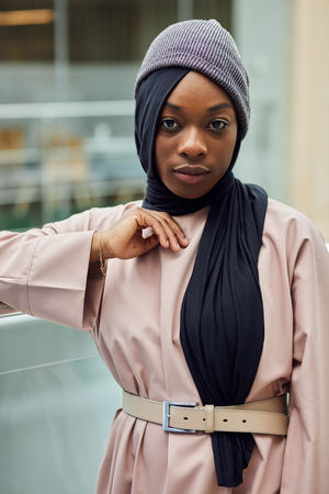 Portrait of a beautiful young African muslim businesswoman in stylish religious outfit. People, Fashion, Religion concept.