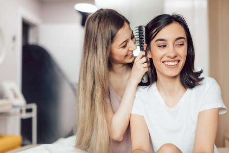 two positive girls having fun while taking care of themselves. close up photo.happiness, lifestyle Stock Photo