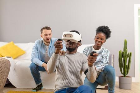 Happy couple trying on 3D virtual reality goggles. Having fun trying new technologies. Virtual adventure. Фото со стока