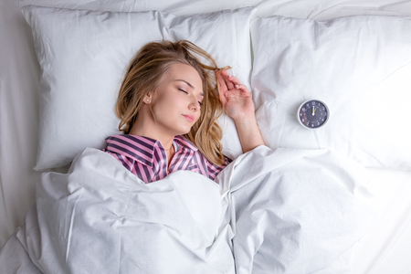 beautiful woman sleeping in bed. top view photo. mental rest, copy space, weekend, holiday