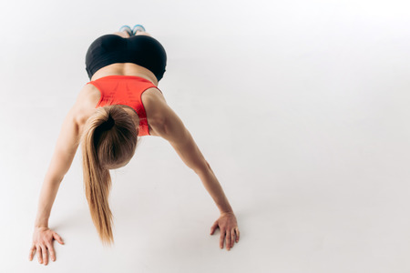 youngawesome pgirl with strong arms. copy space. isolated white background Stock Photo