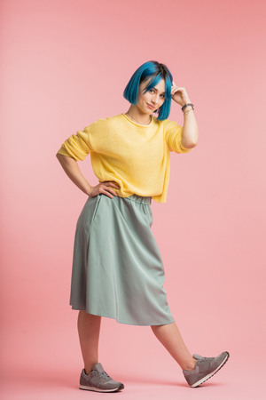 smiling attractive girl demonstrating retro style in clothes. full length photo, fashion, creativity concepts