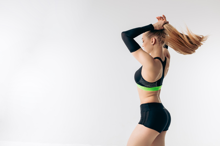 young female runner touching her hair.copy space. back vew shot.sportswoman has hair dressed. Stockfoto