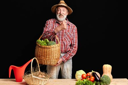 Grandfather came from local eco farm market, taking out lush raw vegetables and fresh eggs that he bought, having great mood, waiting his grandchildren to come for summer holidays.