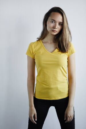 woman in yellow T-shirt and black pants has spots because she has worked with certain chemical substances. close up photo. isolated white background, studio shot.