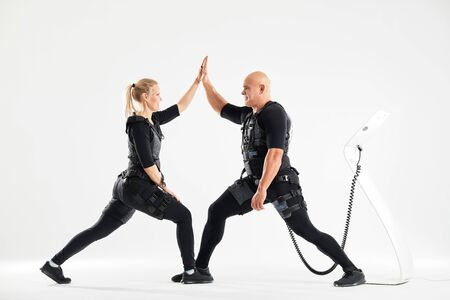 positive fit man and woman holding their hands and enjoying modern training. active life.