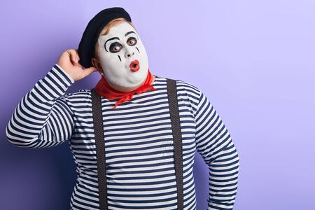 funny plump mime scratching his head and looking at the camera, being surprised at sale, discounts. copy space.place for advert, text