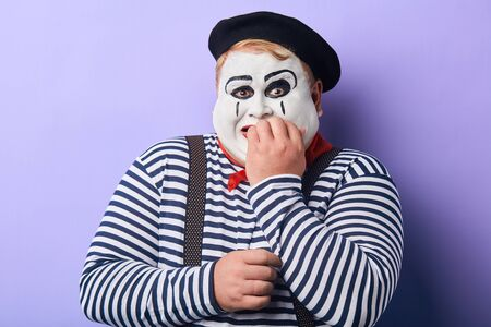 Terrified fat mime artist being afraid of children. facial expression. emotion and feeling, fear and comedy concept Reklamní fotografie