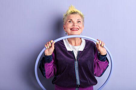 stylish mature woman enjoying sporty life, senior woman adores sport. close up portrait 写真素材 - 128821893