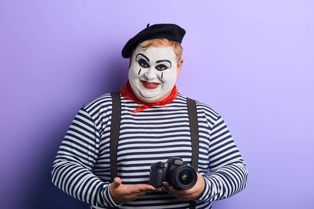 cheerful smiling performer showing professional digital camera. close up photo. advert , sale, discount , technology