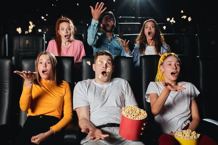 surprised audience enjoying thriller, cinema goes are crazy about film, leisure time Stock Photo