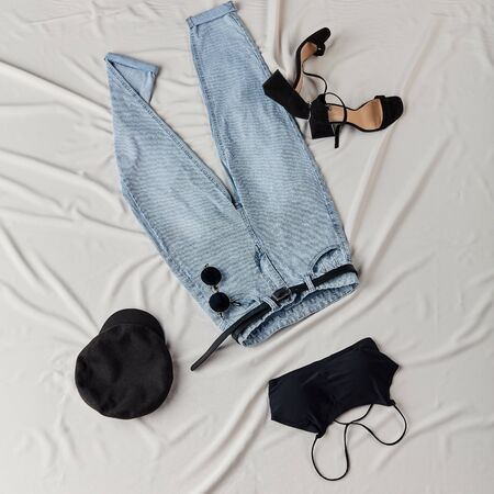 set of summer outfit for glamour girls, top view flat lay shot.