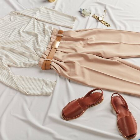 brown leather sandals suits, matches with any clothes, presentation of footwear. travel in comfort clothes , second hand