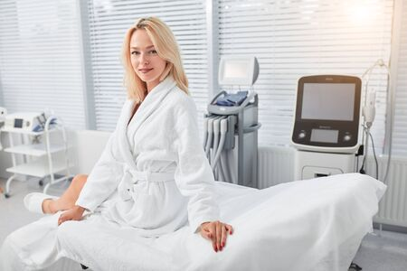 positive attractive female client having a rest after medical treatment, health and body care, lifestyle Stok Fotoğraf