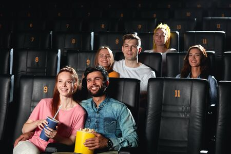 romantic couple gets pleasure from soap opera at the cinema