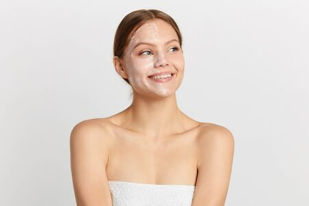 pretty awesome smiling girl wearing white towel looking away. close up portrait, studio shot, copy space. place for text, advert Reklamní fotografie - 129713950