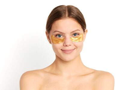 effective new cosmetic tool.woman with anti-wrinkle eye patch, close up portrait, isolated white background, studio shot Banco de Imagens