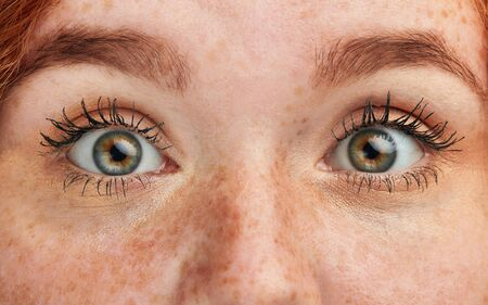 cropped photo of beautiful magic green female eyes. beauty, people concept