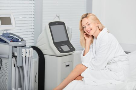 smiling cheerful blonde girl resting at clinic. close up photo.