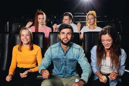 young people having different reaction on the plot of film, some of them like the movie, others dont like.