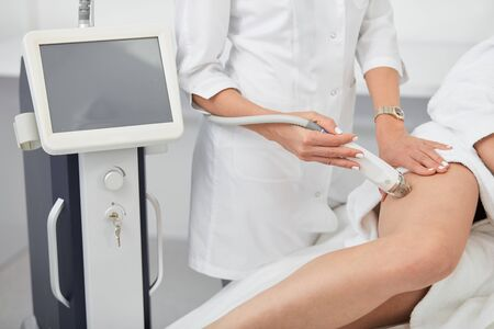 slim girl taking after her legs, new technology in medicine. close up cropped photo.healthy lifestyle
