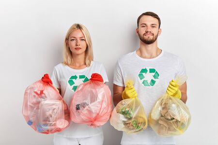 young ambitious people taking care of environment. close up portrait, global problem, isolated white background, good tradition.the solution to this pollution problem