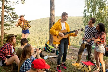 pleasant young people having fun in the fresh air, entertainment, happiness