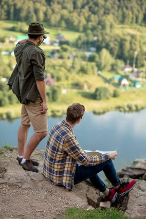 two travellers enjoying amazing nature, get inspiration from wonderful landscape, exploring area