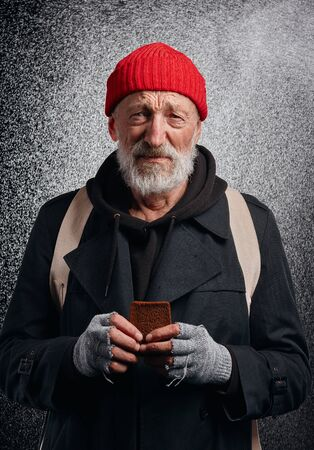Beggar male cry about lack of food. Dream about shelter and food. Homeless man standing under rain, look at camera