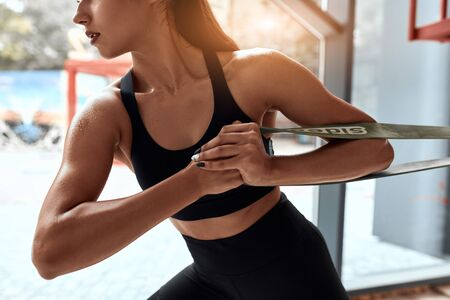 cropped slim attractive woman training cross fit in gym. Window background. Healthy lifestyle, sport, cross fit lifestyle Stok Fotoğraf