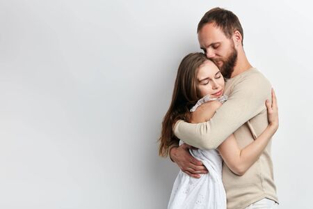 man supports his girlfriend as she has serious problems, close up photo. isolated white background, copy space, lifestyle, free time. spaare time Imagens